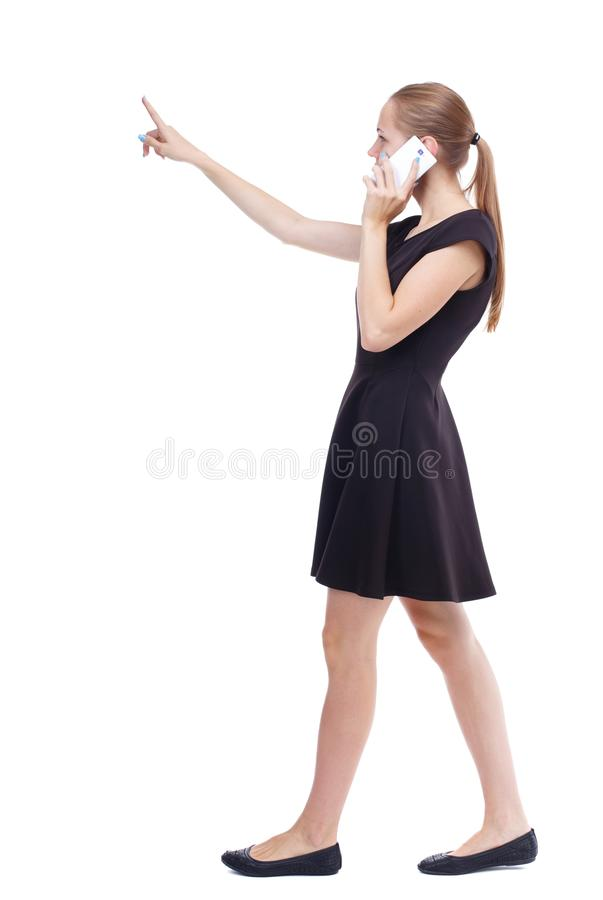 Side view of walking woman royalty free stock photography