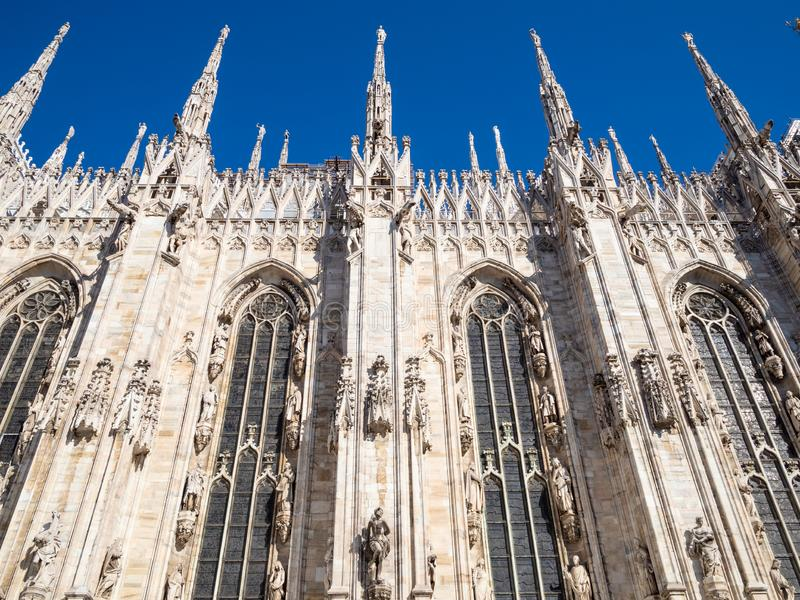 Side view of wall of Milan Cathedral. Travel to Italy - side view of wall of Milan Cathedral Duomo di Milano in Milan city in morning stock photography