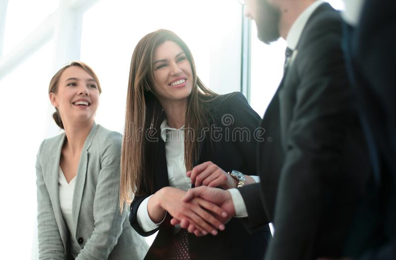 Side view.welcome and handshake of business people. royalty free stock images