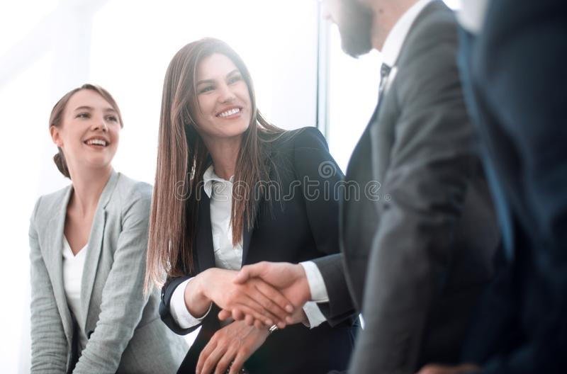 Side view.welcome and handshake of business people. stock images