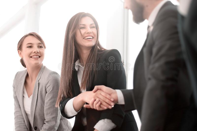 Side view.welcome and handshake of business people. stock photography