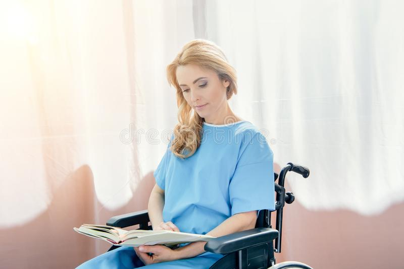 side view of wheelchair woman stock photography