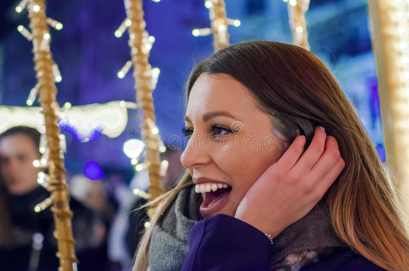 Side view woman on the festive Christmas market at night. Woman. On the festive Christmas market at night royalty free stock images