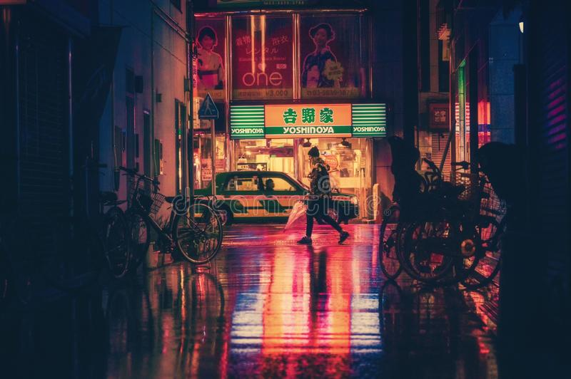 Side View of Woman in Illuminated City at Night royalty free stock photo