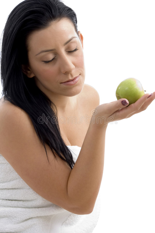 Download Side View Of Woman Posing With Apple Stock Image - Image: 7365533