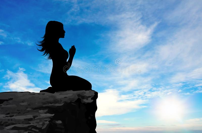 Side view of a woman praying at sunset. Girl silhouette side view on a high rocky cliff praying, blue sky with white clouds and sun as background royalty free illustration