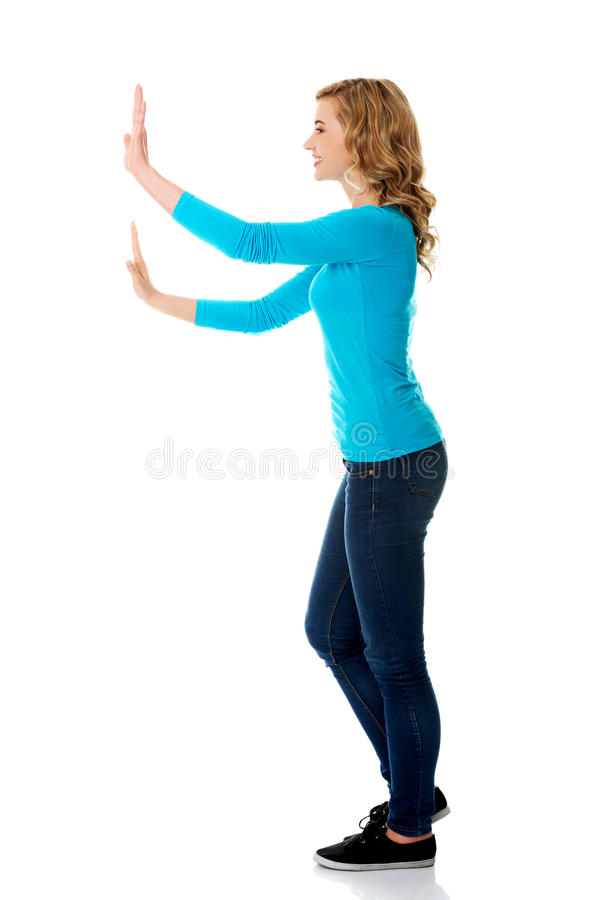 Side view woman touching imaginary screen royalty free stock photos