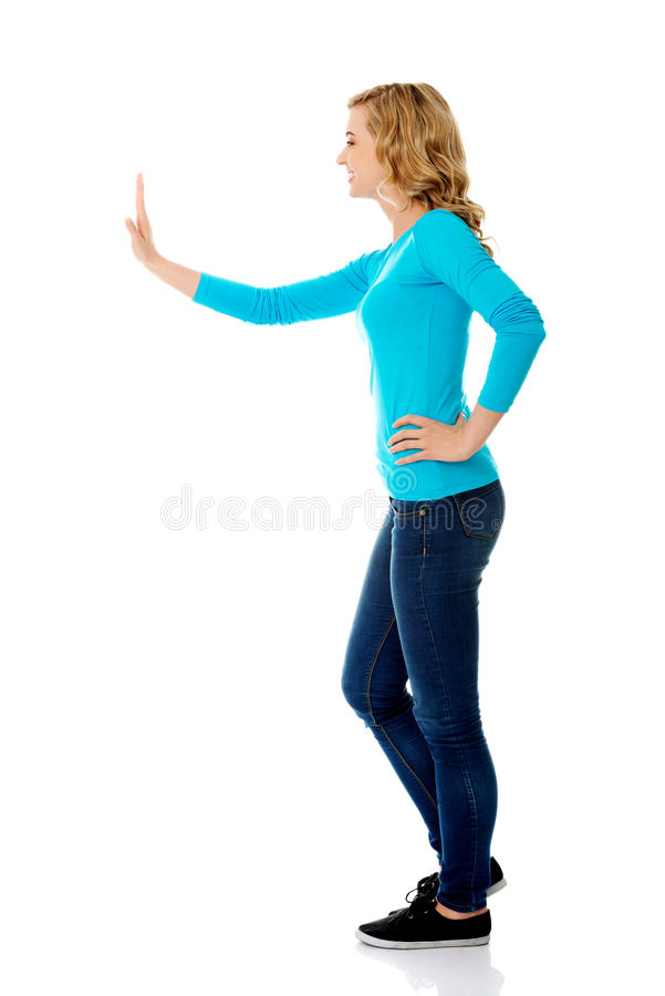 Side view woman touching imaginary screen stock images