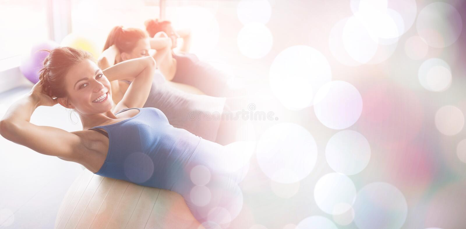 Side view of women doing situps royalty free stock photos