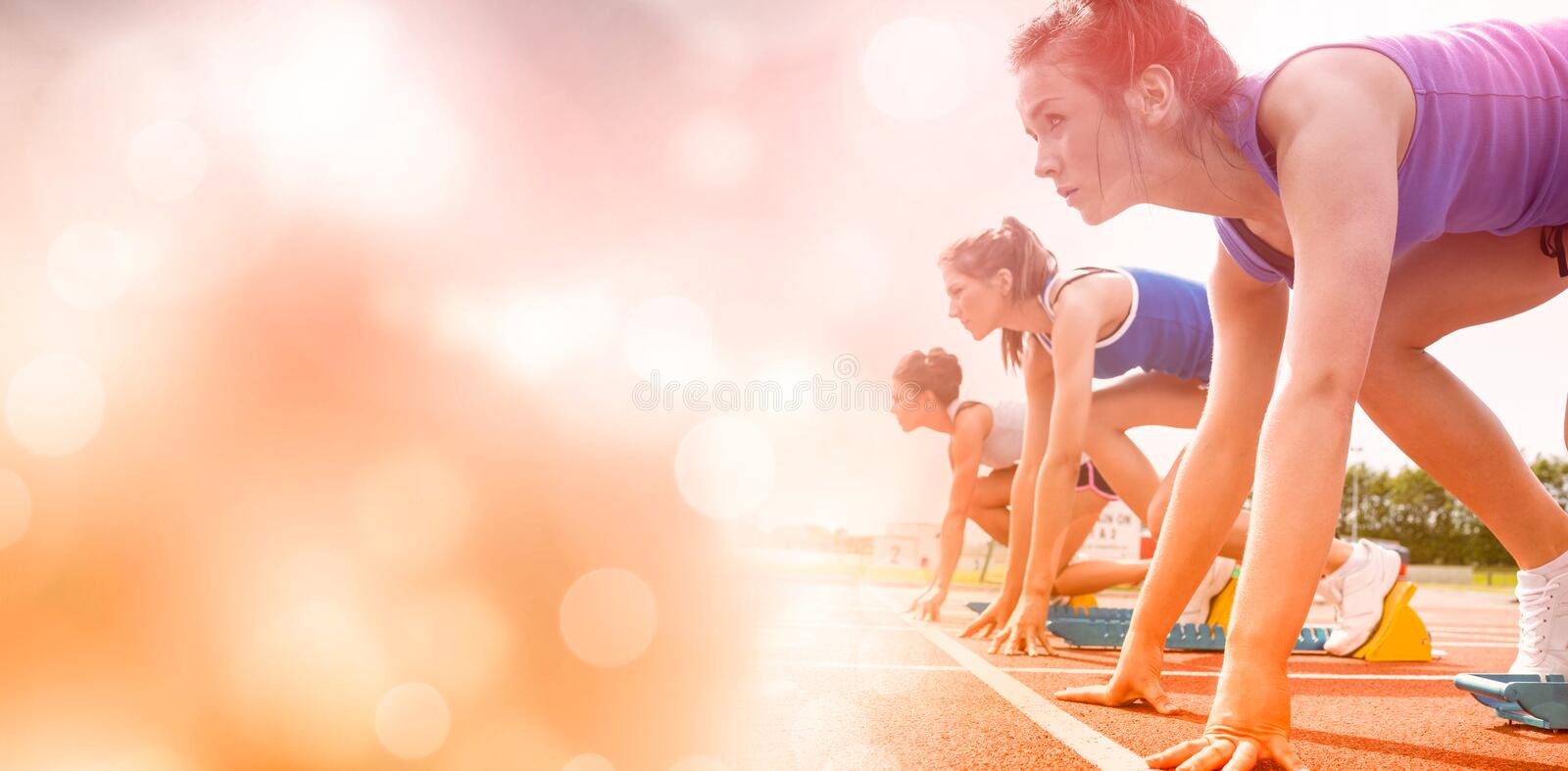 Side view of women on starting line stock photography