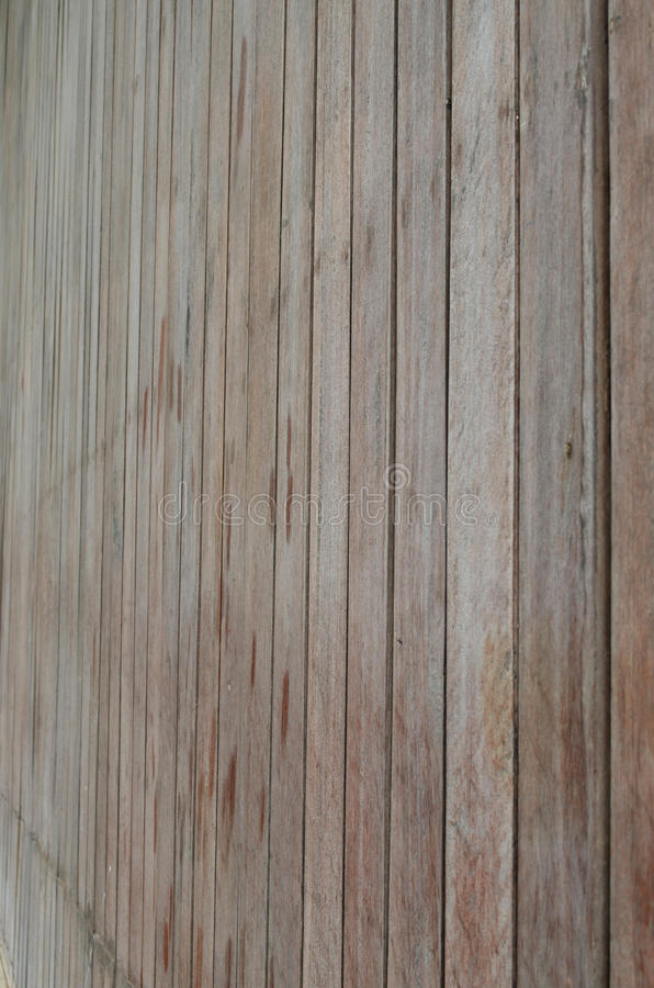 Side view of wood slat wall. Side view of brown wood slat wall fasten with nail for background and texture stock photography