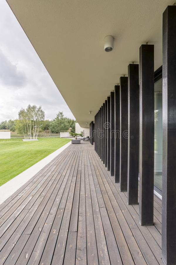 Terrace with black pillars royalty free stock image