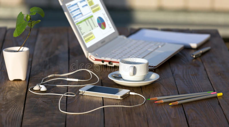 Side view of working Place on natural wooden Table Outdoor royalty free stock photos