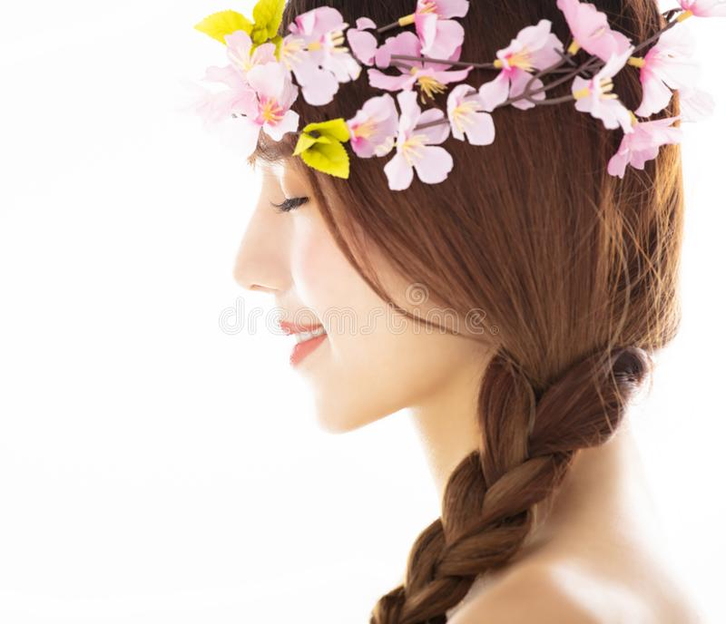 Side view of young smiling beauty face with flower royalty free stock photos