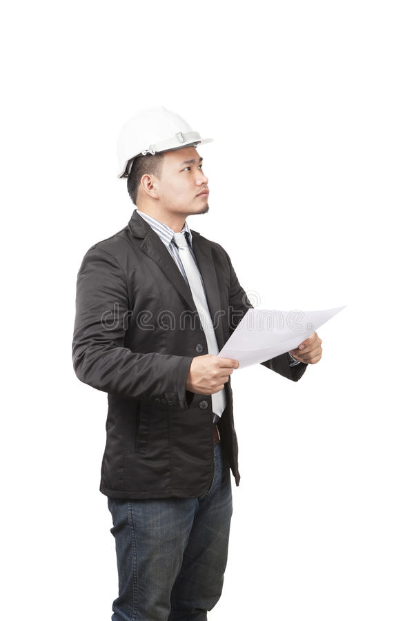 side view of young asian wearing safety helmet working engineering man holding project paper work isolated white background use f stock photos