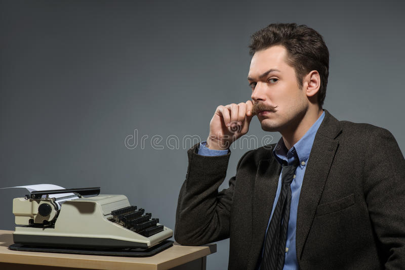Side view of young author deep in thoughts royalty free stock photos
