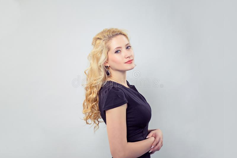 Elegant young woman in black dress royalty free stock photo