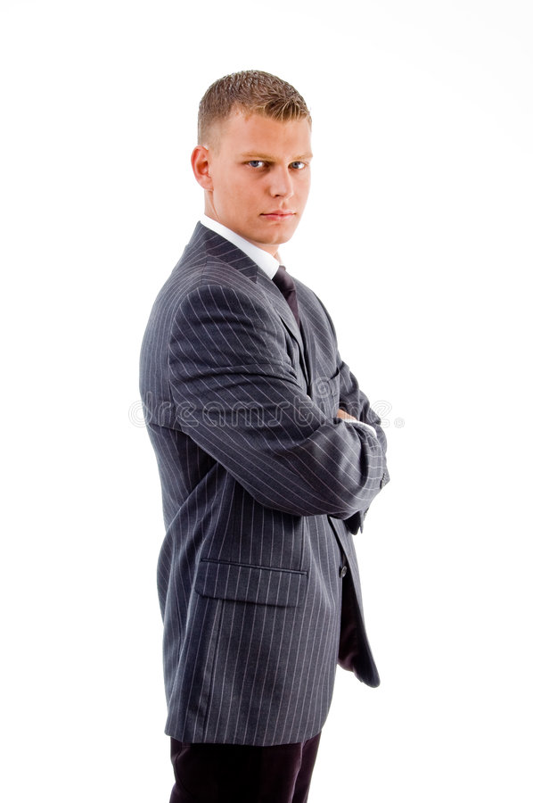 Side view of young boss with crossed arms royalty free stock photography