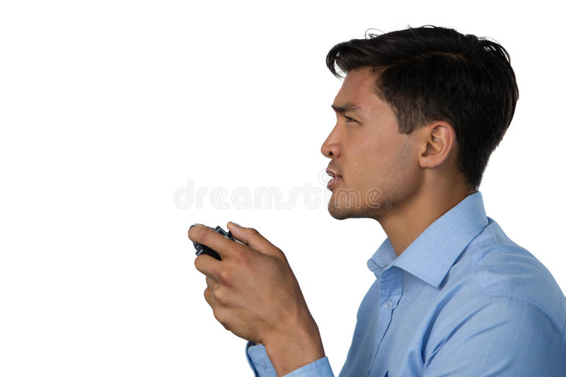 Side view of young businessman playing video game stock images