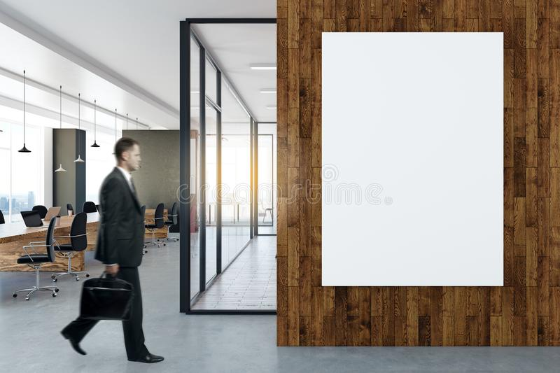 Download Man In Office With Poster Stock Photo. Image Of Architecture    109067490