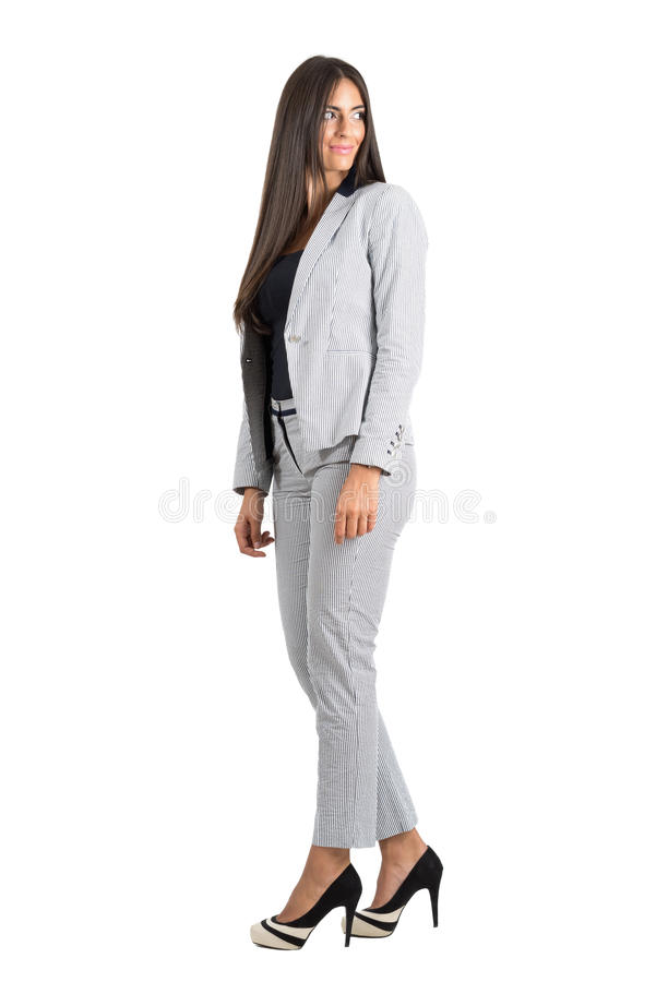 Side view of young businesswoman looking behind over the shoulder royalty free stock photo