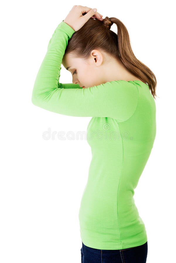Side view of young depressed woman stock photography