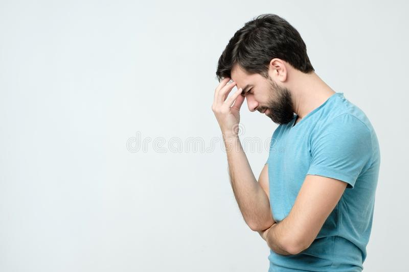 Side view young handsome spanish man thinking stock image
