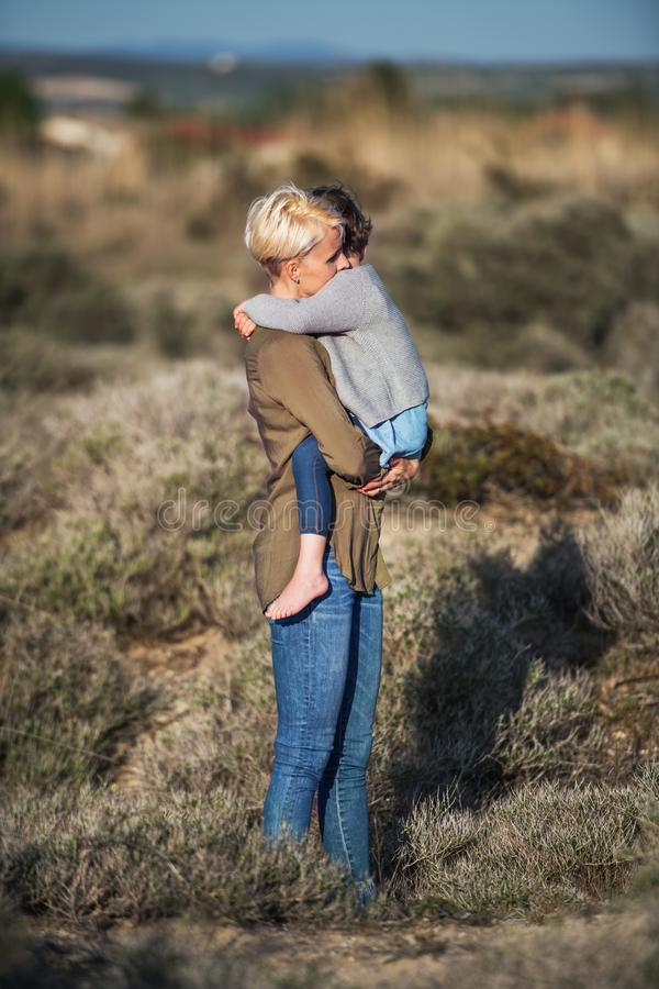 Side view of young mother with small daughter in mediterranean nature. royalty free stock photo