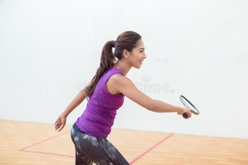 Young squash player holding the racket during game on a professional court royalty free stock photos
