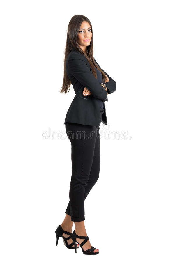 Side view of young successful business woman with crossed hands looking at camera stock photos