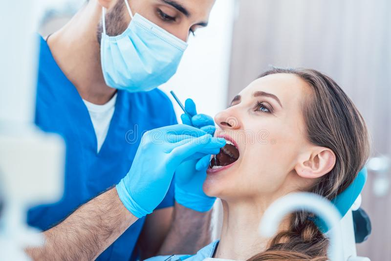 Young woman during painless teeth cleaning done by a reliable de royalty free stock photo
