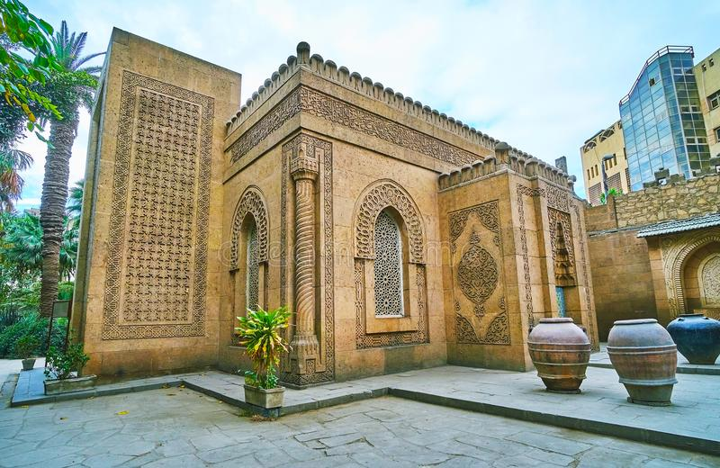 The carved exterior of mosque of Manial Palace, Cairo, Egypt. The side wall of a mosque of Manial palace complex with fine carved patterns, inspired by Moroccan royalty free stock photos