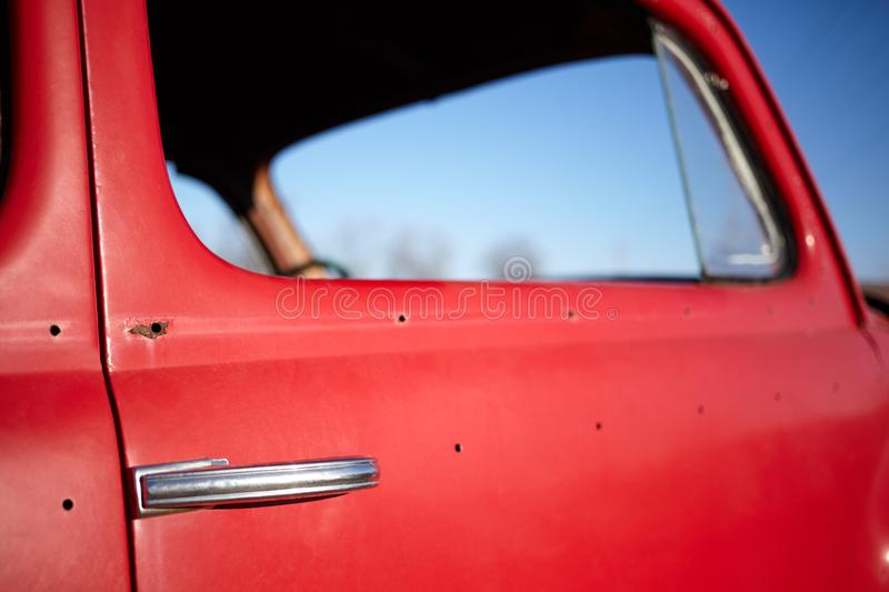 Side window of an old vintage red car royalty free stock photos