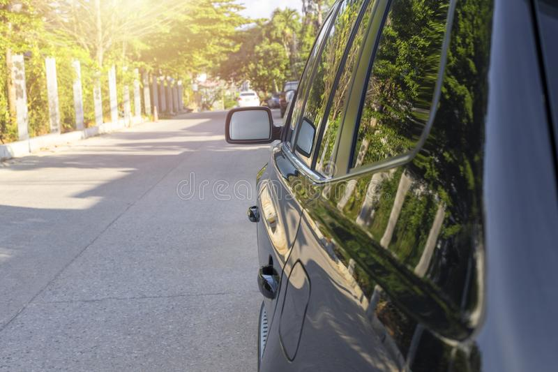 Side wing mirror and door handle black color SUV car royalty free stock images