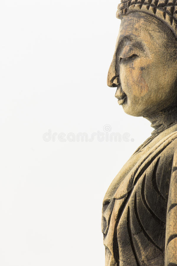 Side of wood buddha isolated on white background stock images