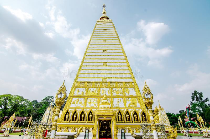 4-sided shape pagoda : architecture landscape of white and gold pagoda at wat Phrathat Nong Bua in Ubon Ratchathani province,. Thailand stock image