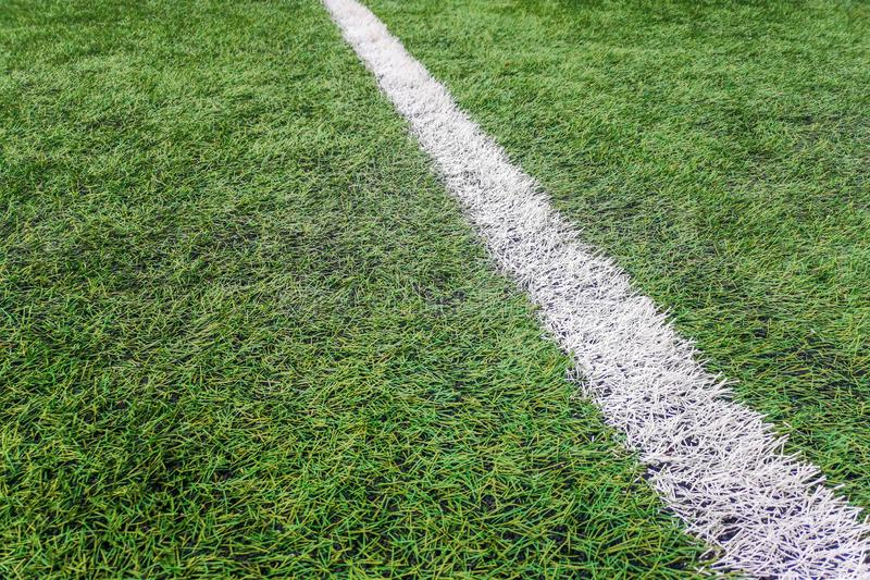 Sideline football field, Sideline chalk mark artificial grass soccer field. Football background royalty free stock images