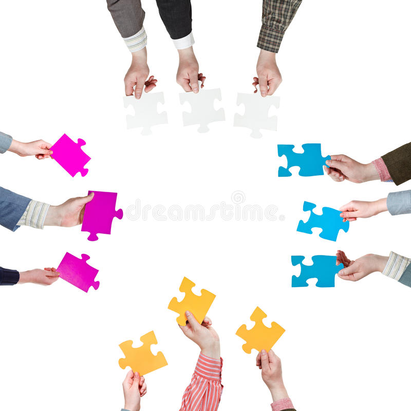 Sides with people hands holding puzzle pieces stock photography