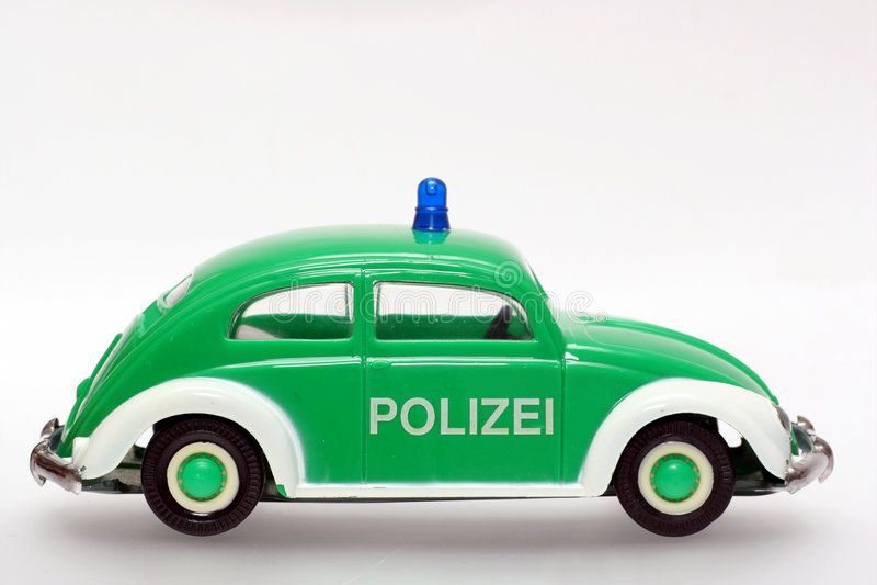 Sideview alemán del escarabajo de VW del coche policía del juguete fotografía de archivo libre de regalías