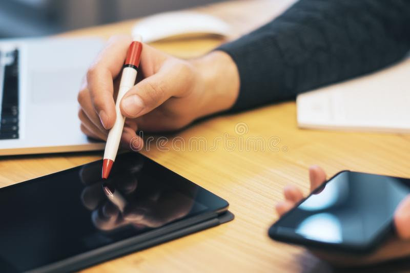 Sideview of businessman hand using gadgets royalty free stock photography