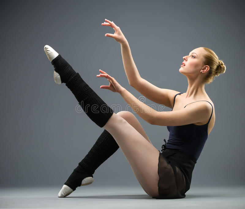 Sideview of dancing on the floor ballerina stock image