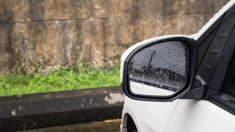 Sideview mirror with water drop after rain.  royalty free stock image
