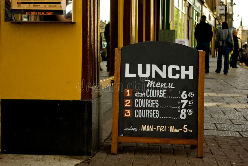 Sidewalk cafe menu board with writings lunch time royalty free stock image