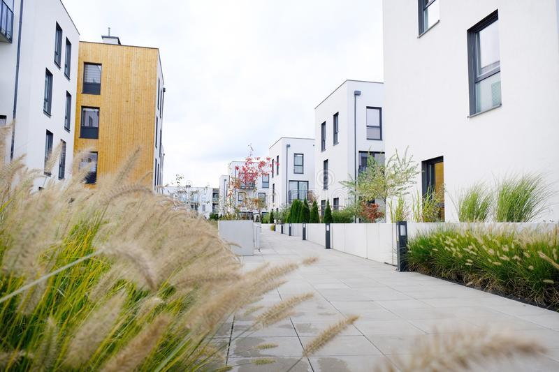 Sidewalk in a cozy courtyard of modern apartment buildings condo with white walls stock image