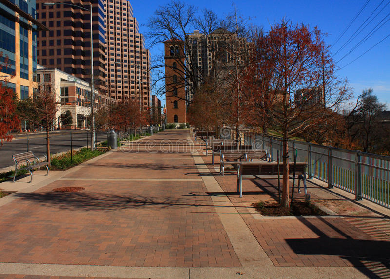 Sidewalk in downtown austin texas. Sidewalk along lady bird lake in downtown Austin, Texas royalty free stock image