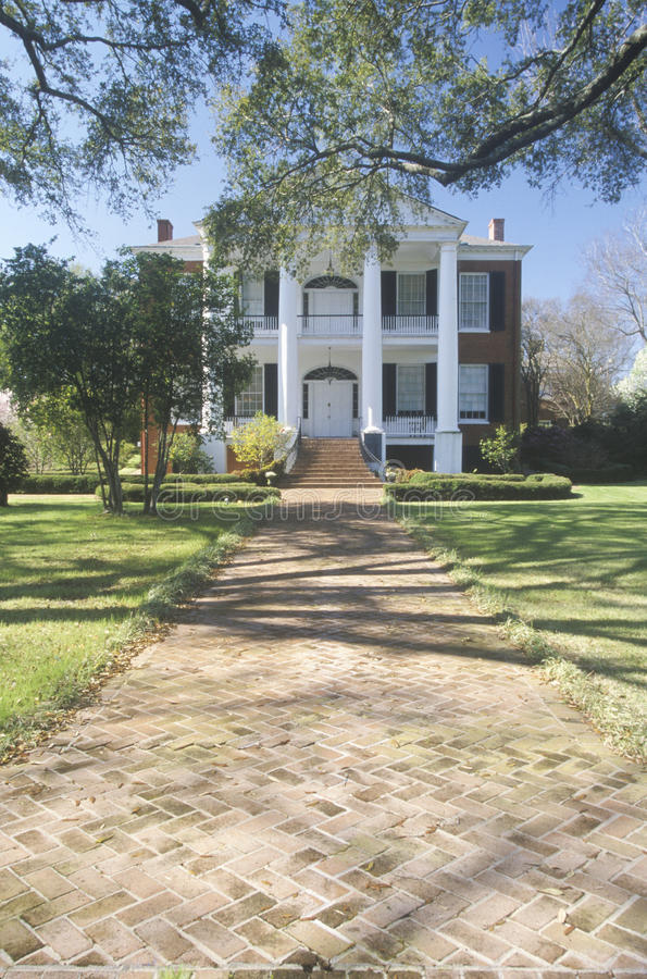 Sidewalk leading to Rosalie mansion in historic Southern Natchez, MS stock photography