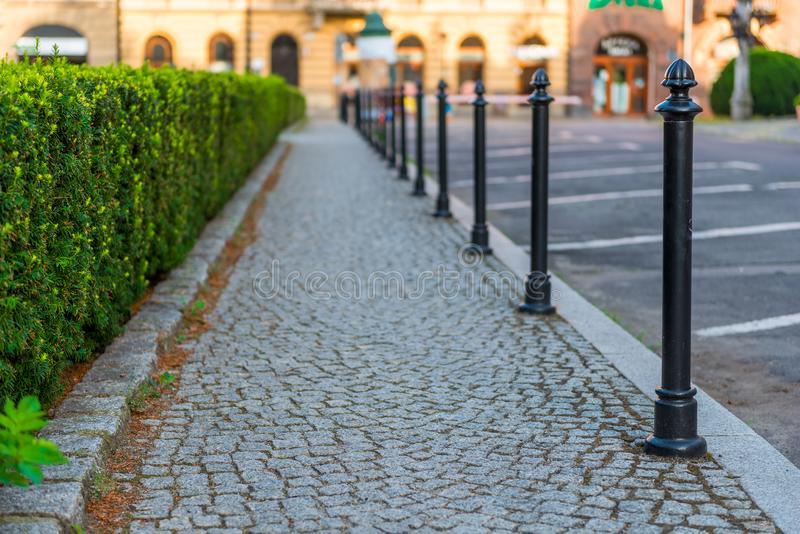 Sidewalk, lined with gray paving stones. Closeup stock photography