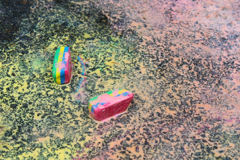 Sidewalk paint preparation and use in a daycare/home school setting.  royalty free stock image