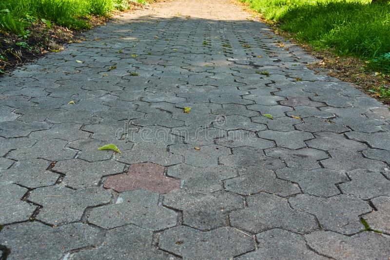 The sidewalk paved with brick blocks goes with the prospect of a distance. Comfortable straight the sidewalk.  royalty free stock photo