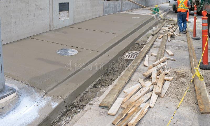 Sidewalk reconstruction stock images
